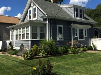 AFTER PHOTO(s) The House - August 2015 (with new windows, siding, chimney and front storm door) All Landscaping done by yours truly. :-)
